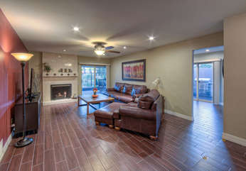 Large and comfortable great room has sliding doors to backyard and covered patio