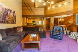 Living Room, sectional couch, two arm chairs,wood burning fireplace and flat screen tv/dvd player, deck with wood and bbq