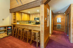 kitchen counter with 5 stools