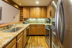 Updated kitchen with granite counter tops and stainless appliances
