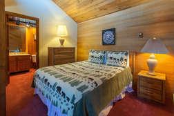 Loft Bedroom #4- upper level, queen bed and full en-suite bathroom, flat screen tv