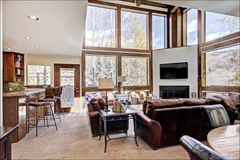 Stunning Living Room has Vaulted Ceilings and Large Picture Windows