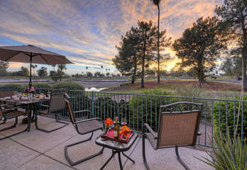 Cheers to the gorgeous sunset and golf course views from private patio