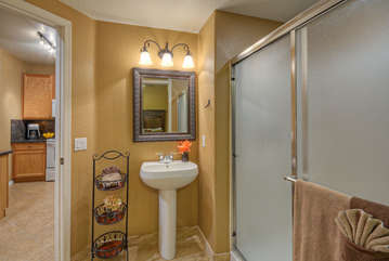 Second bath features walk-in shower and is accessed from kitchen and second bedroom