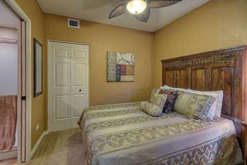 Second bedroom has queen bed and door to second bath