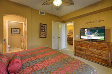 Deluxe king bed, walk-in closet and large TV in pretty master suite