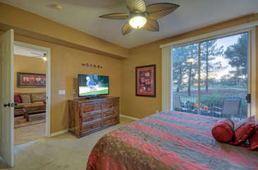 Views of Superstition Springs Golf Course and access to private patio from master suite