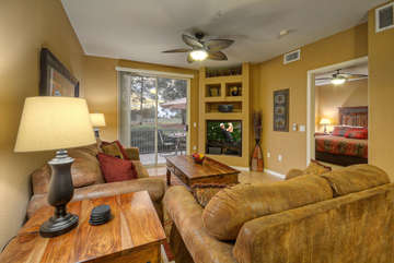 Furnishings in great room are arranged to view large TV and picturesque outdoors, or to listen to stereo