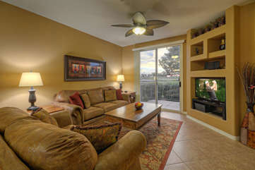 Great room with access to private patio is professionally decorated to be attractive and comfortable