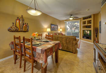Stylish dining area between great room and kitchen seats 4. Cabinet on right has martini and wine glasses.