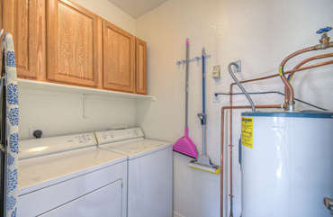 In-unit laundry room with washer and dryer for completing laundry tasks