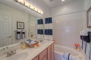 Master bathroom has tub/shower combination and dual vanity sinks