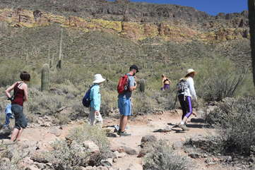 Both locals and visitors enjoy the desert and mountain scenery on nearby trails