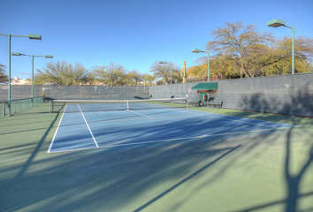 Community tennis courts are a volley away; monthly membership required