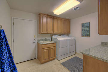 Separate and modern laundry room has new appliances and provides all you need for completing laundry chores