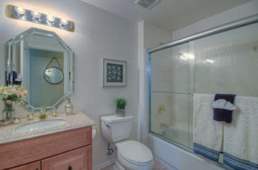 Bathroom in upstairs master suite has tub/shower combination