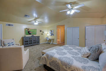 Comfie chairs and large TV are appealing qualities of upstairs master bedroom