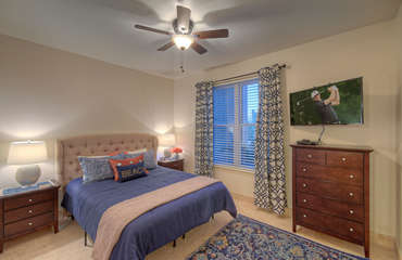 Third bedroom on first floor has queen bed and large television for your viewing pleasure