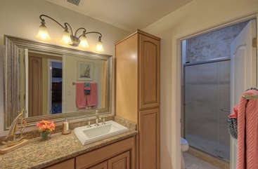 First floor bathroom features a walk-in shower