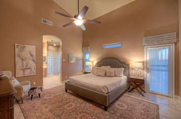First floor master suite with sloping ceilings and access to patio at back of home is nothing short of exquisite