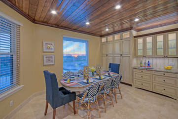 Classy dining area with stunning views both day and night seats 8 and has large sideboard for serving exotic food and drinks