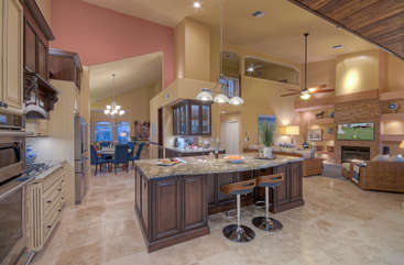 Updated and extremely elegant designer kitchen with sloping ceilings has high-end appliances and accessories