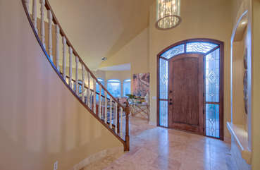 Elegant entrance way with winding staircase welcomes you to upscale and alluring home