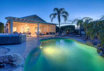 Welcome to beautiful NE Mesa home with heated pool, spa, citrus trees and large covered patio