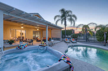 Backyard has resort amenities that include covered patio, built-in gas grill, dining furniture, hot tub and pool which can be heated for additional fee.