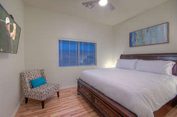 Second bedroom has deluxe king bed and large television