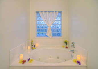 Divine garden tub for the ultimate in tranquility or when tired muscles need rejuvenating
