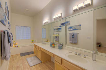 Stunning master bath features double vanity sinks and separate garden tub and shower