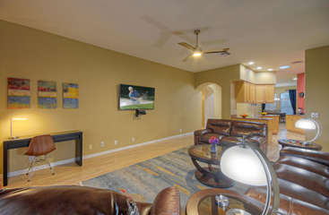 Large television in great room for viewing pleasure; desk accommodates work at home projects