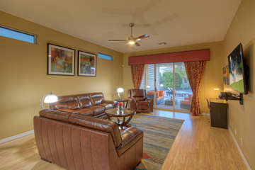 Great room has large TV and patio doors that open to backyard oasis
