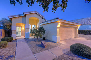 Pretty home with two car garage has impressive upgrades and amenities
