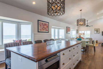 2nd floor has an open floor plan with cathedral ceilings.  There is additional seating for your guests at the wood kitchen island.