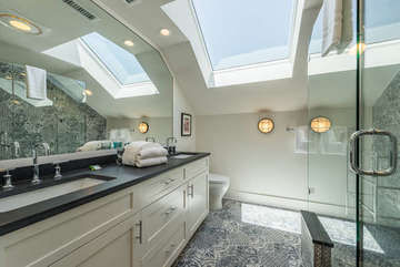 The full bath is accessible from the hall and has a double sink set in granite.