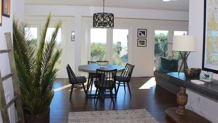 The lower level family room is surrounded by windows with beach views.