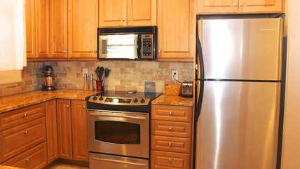 The stainless steel appliances add to the beauty of the kitchen.