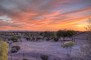 Sunset vistas from home's deck are a vibrant tapestry of color