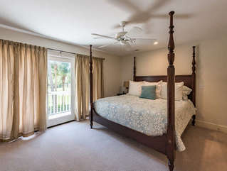 2nd en suite master bedroom upstairs features a king size bed, bathroom and sliding glass doors to a balcony overlooking the golf course.