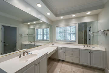 This large master bath features double sinks, plenty of counter space, a garden tub, separate shower.