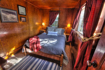 The Captain's bedchamber, a wood-paneled delight.