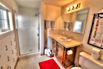 Bright, clean bath with walk-in shower.