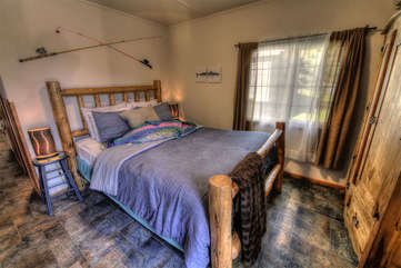 Country comfort, and lovely flooring in the bedroom.