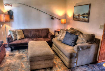 Comfortable living area features two twin sleepers.