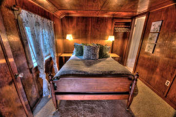 The bedroom is a wood-paneled jewel-box of peace and quiet.