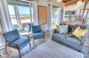 Comfortable seating in the second floor living area with bay and ocean views