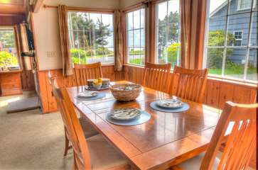 Simple elegance and sunlit dining with vaulted views in the dining room