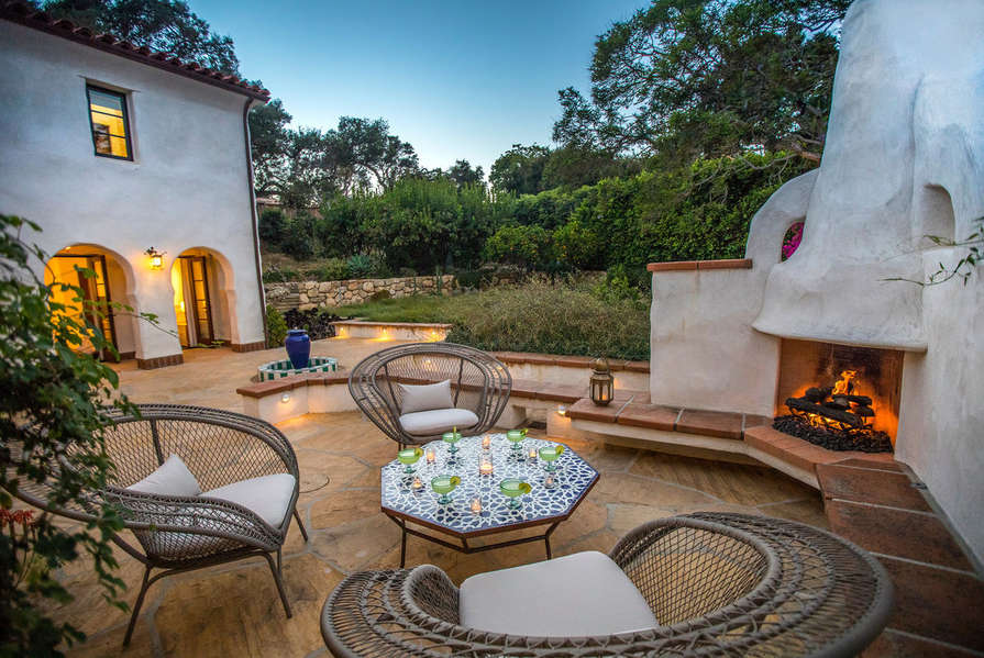 Enjoy a beverage by the outdoor fireplace